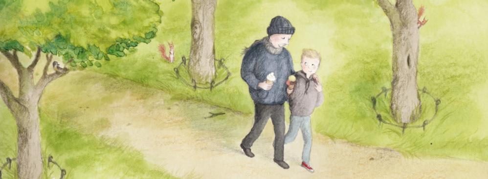 Vater und Sohn spazieren durch einen Park